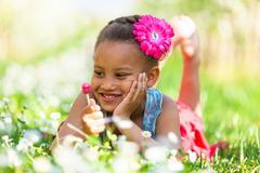 Outdoor portrait of a cute young black girl smiling - african people Stock Photos