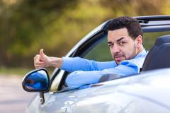 Young black latin american driver making thumbs up Stock Photos