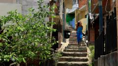 Children walking down stairs in Latin American neighborhood Stock Footage