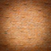 vignette style red brick wall background - stock photo