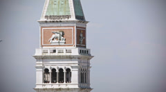 0340 Venice St Mark's Tower Bell. A plane is taking off Stock Footage