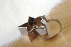 heart and star shaped cookie cutters - stock photo