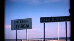 Entering Georgia sign, Airstream crash Stock Footage
