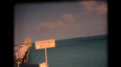 Seven Mile Bridge sign and Leaving Key West Stock Footage