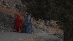 Two tourists walking in the evening, near Lindos, Greece. Stock Footage