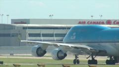 KLM 747-400 Taxi towards terminal Stock Footage