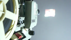 The old film projector shows cinema. - stock footage