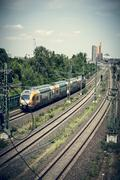 Railroad and train with potsdamer platz in background,, berlin Stock Photos
