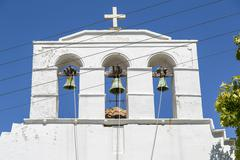 detail of a greek church with blue sky in background - stock photo