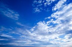 White cirrus clouds and blue sky Stock Photos