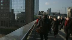 Large crowd of pedestrians walk over London Bridge 56. 4K version Stock Footage