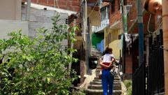 Children walking up stairs in Latin American neighborhood Stock Footage