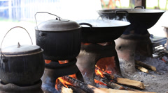 People cook on fire on the market in island of Negros, Philippines Stock Footage