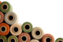 collection of vintage yarn spools frame white background - stock photo
