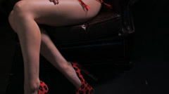 Woman red lingerie on chair slide Stock Footage