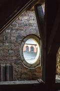 oval open window of a roof timbering - stock photo