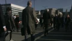 Large crowd of pedestrians walk over London Bridge 49. 4K version - stock footage