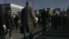 Large crowd of pedestrians walk over London Bridge 49. 4K version Stock Footage