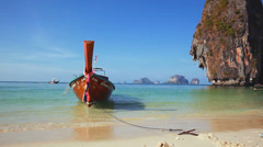 Longtail boat at the tropical beach, Andaman sea, Thailand - stock footage