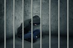 burglar in jail - stock photo