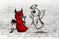 angel and devil fighting; doodle drawing on white brick wall - stock illustration