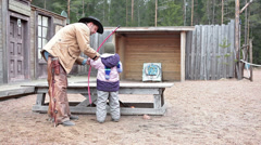 Cowboy shooting with bow when learning kid Stock Footage