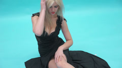 Woman wearing black dress on background Stock Footage