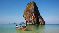 Tropical Paradise beach, Long Tail Boat at white-sand beach Stock Footage