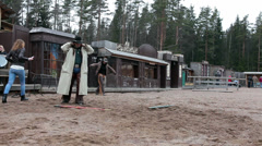 Cowboy explaining rules of the game for visitors on the ranch, Russia Stock Footage