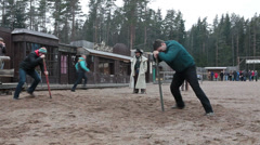 People turning around pole. One that has more stability faster finds prize Stock Footage