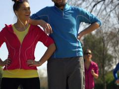 Happy joggers, couple standing in park, super slow motion, shot at 240fps NTSC Stock Footage