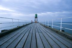 Navigation beacon on Whitby pier - stock photo