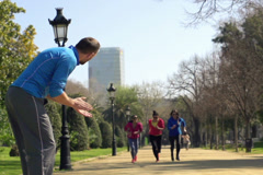 Girls race, running in the park, super slow motion, shot at 240fps NTSC Stock Footage