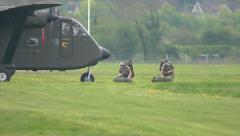 Military Skyvan taxiing past two paras Stock Footage