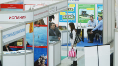 Woman talking with agent at the property exhibition - stock footage