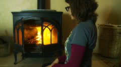 Woman closes doors of house fire Stock Footage