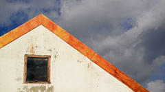 House roof with time lapse clouds in background. 1920x1080, 1080p, hd footage - stock footage