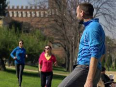 Man looking, admire beautiful female joggers running in the park NTSC Stock Footage