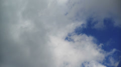Passing of time metaphor. Time lapse footage of blue sky with clouds. Stock Footage
