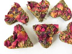 Tea bricks made of pressed green tea and rose petals Stock Photos