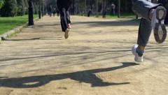 Joggers running in the park, super slow motion, shot at 240fps HD Stock Footage