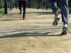 Joggers running in the park, super slow motion, shot at 240fps NTSC Stock Footage