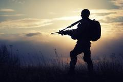 Silhouette of US marine - stock photo