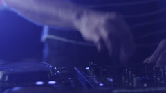 Dj Mixing Tracks in Nightclub - stock footage