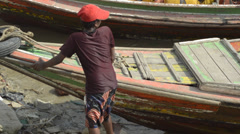 PORT, QUAY & JETTY:  ASIA - Boat operator prepares his boat Stock Footage