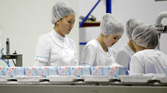 Working women at the factory Stock Footage