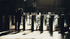 People passing through the ticket gates in metro Stock Footage