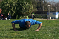 Young man doing press ups in the park, super slow motion, shot at 240fps NTSC Stock Footage