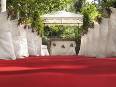 Red carpet patch to altar for outdoor wonderful wedding Stock Photos