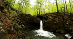 A small powerful mountain falls among the stones Stock Footage